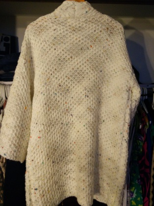 The wide sleeves makes it possible to wear a thick sweater underneath and have room in the arms